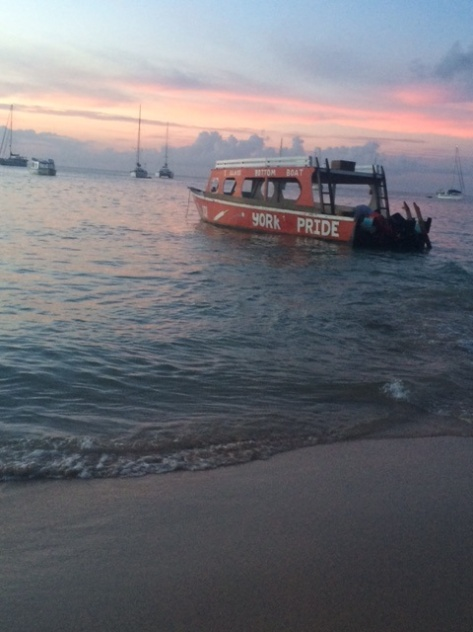 A sunset picture of the glass bottom boat at Pigeon Point Beach, Tobago.